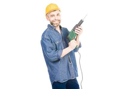 Portrait of confident Caucasian foreman holding electric drill and smiling at camera on white background