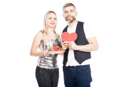 Portrait of happy attractive couple holding heart shape