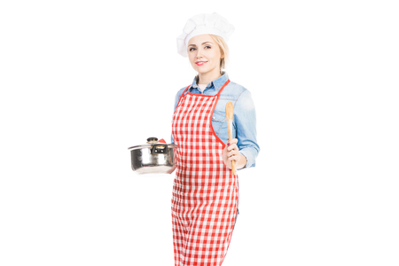 Portrait of beautiful Caucasian woman with chef hat and saucepan smiling at camera on white background