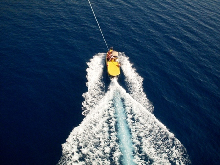 speedboat: boat and a speedboat parachute dragging photo