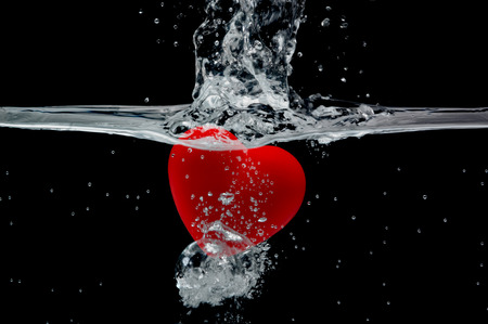risky love: Water heart Stock Photo