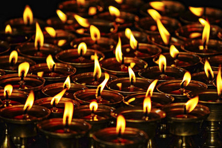 piety: Budhist candles Stock Photo