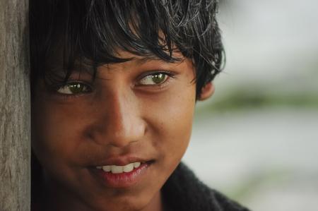KATHMANDU, NEPAL - AUGUST, 28, 2010 Child in Kathmandu near the gate of his house smiles at the photographer