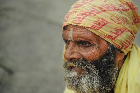 Kathmandu, Nepal, August 29, 2010. Sadhu staring at Pashupatinath Temple in Kathmandu