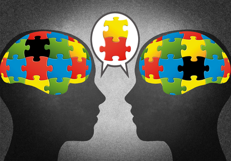 Heads with puzzle Stock Photo