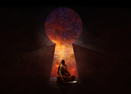 Buddhist novice in front of key hole with universe behind