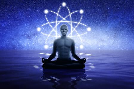 Yoga men with the universe Фото со стока