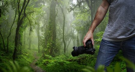 Photographer taking pictures in the middle of nature 版權商用圖片