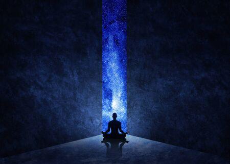 Yoga man in front of open door with universe behind 写真素材