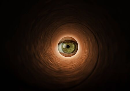 Eye looking through a tube Stock Photo