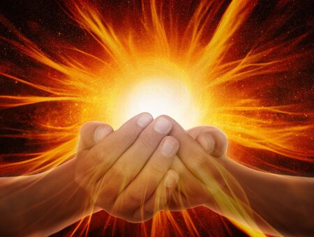 Hands with light and energy rays Archivio Fotografico