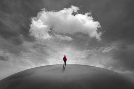 Silhouette of man in front of clouds