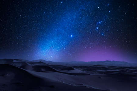 Starry night in the desert with dunes