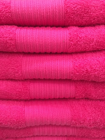 z fold: hot pink tower of towel Stock Photo