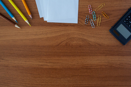 Stationery on wooden table with calculator background Standard-Bild