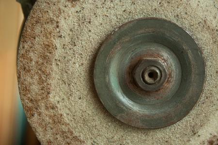Old rusty Grindstone grinder in the workshop