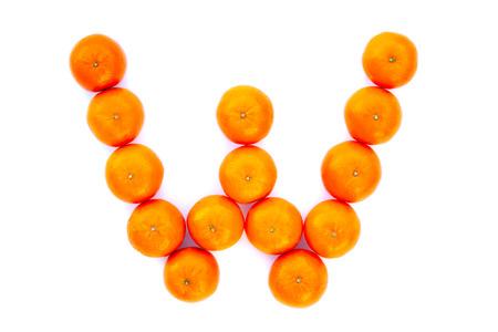 Letter solved with tangerines isolated on white background. Mandarine «W» letter