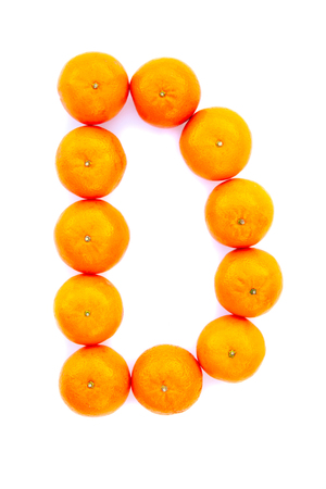 Letter solved with tangerines isolated on white background. Mandarine «D» letter