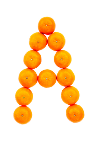 Letter solved with tangerines isolated on white background. Mandarine «A» letter