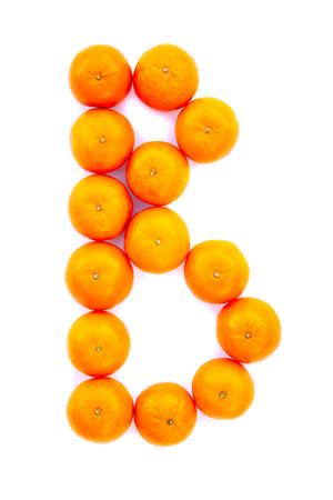 Letter solved with tangerines isolated on white background. Mandarine «B» letter