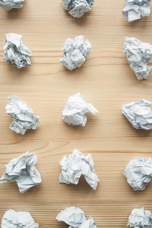 Many crumpled white paper balls from above background. Texture of crumpled paper balls. Crumpled paper as brainstorming, creativity concept, mistakes and creation symbol.