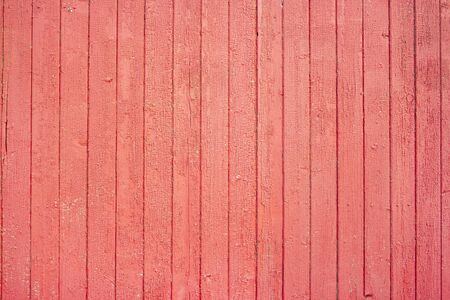 Red painted old and aged wood texture. Red wooden texture for design. Grungy painted wall