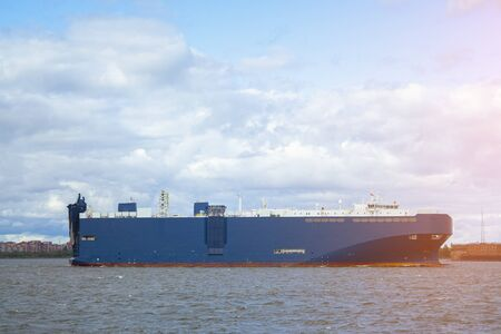 huge blue barge with large containers on board. shipping cargo transportation by sea 免版税图像