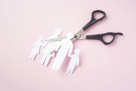 black scissor cutting family paper cut , dysfunctional family, bad children development, divorce parent broken family concept, mental health
