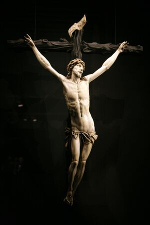 sculpture of jesus christ at the cross photo