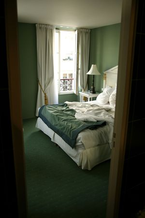 view through a door of a hotel bedroom in paris photo