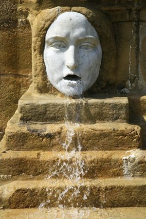rung: mask with water come out its mouth Stock Photo