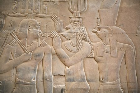 wall with a relief of an egyptian scene with two gods an a king photo