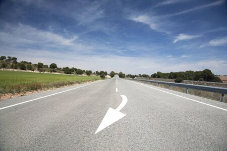 arrow sign painted on the road in spain photo