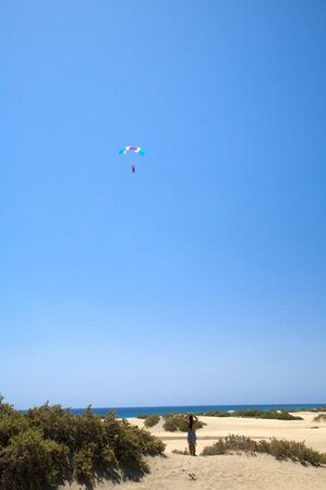 paraglider with a couple flying at the blue sky of Canary Islands spain photo