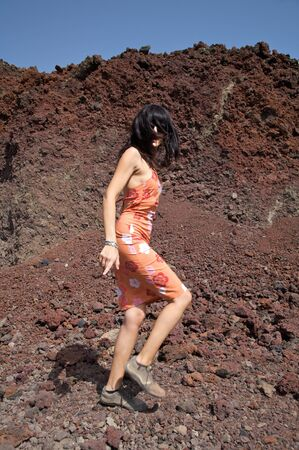 volcanic stones: woman walking on volcanic roks in tenerife spain