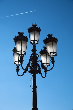 street lamppost with blue sky at the evening photo