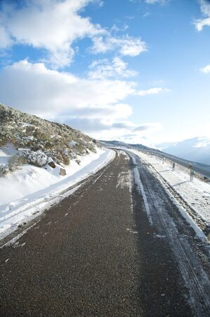 road with snow at gredos mountains in avila spain photo