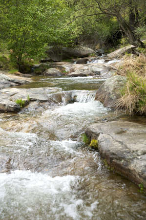 small river at gredos mountains in avila spain photo