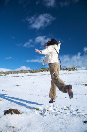 woman walking on snow at gredos mountains in avila spain photo