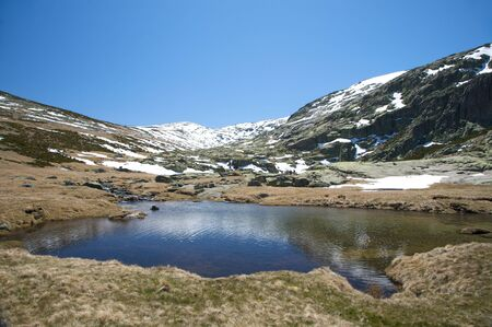river at gredos mountains in avila spain photo