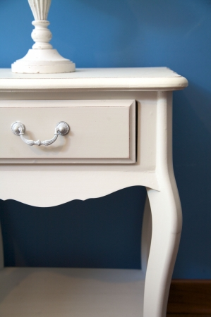 'bedside table': white bedside table and lamp with blue lampshade