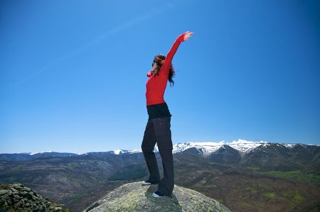 woman at the top of gredos mountains in avila spain photo