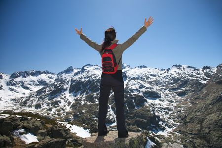 avila: woman at the top of gredos mountains in avila spain