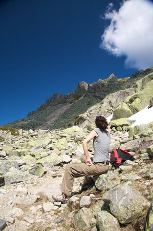 woman hiking at gredos mountains in avila spain photo