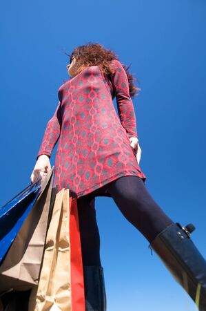 woman on red dress with shopping bags Stock Photo - 5357732