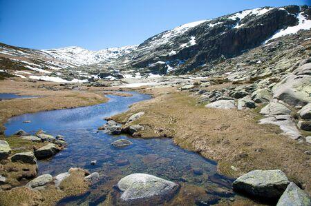 avila: river at gredos mountains in avila spain