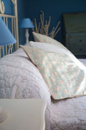 bolster: detail of pillow and bolster of a bed
