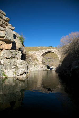 river with bridge at forest in avila spain Stock Photo - 5415567