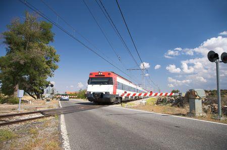 rural level crossing next to segovia city in spain photo