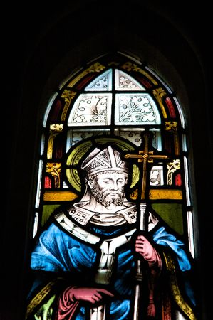 glasswork: coloured glasswork painted a saint with cross